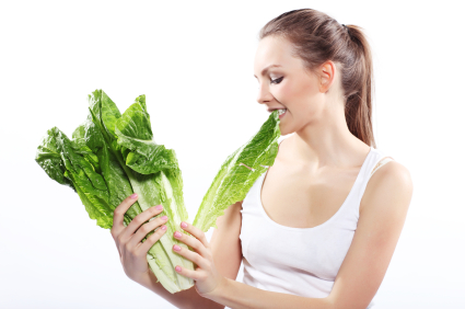 Teen girl eating lettuce